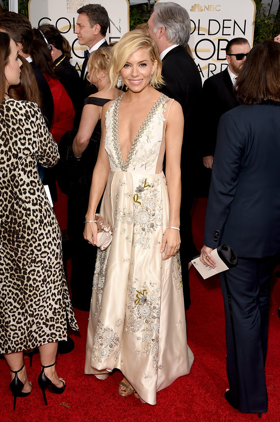Sienna Miller in Miu Miu, Astley Clarke earrings and Tiffany & Co. jewellry